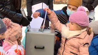 little girl voting