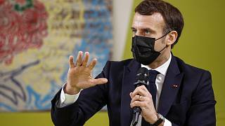 French President Emmanuel Macron gestures as he meets students during his visits at Paris-Sarclay university in Orsay, west of Paris, Thursday, Jan. 21, 2021.