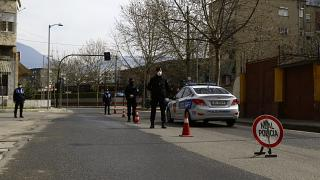 Police stand at a checkpoint in Tirana last March.