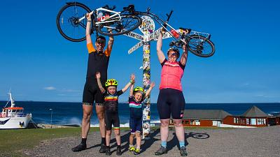 Katie, Tom and their children at John O'Groats.