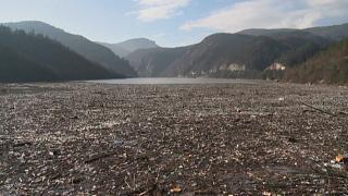 Floating garbage in front of the dam, estimated to be up to 5,000 cubic metres