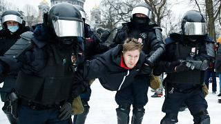 Police detain a man during a protest against the jailing of opposition leader Alexei Navalny in St. Petersburg, Russia. January 23, 2021