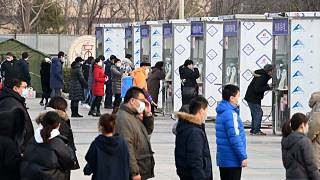 Beijing residents being tested for Covid-19 at a mass testing site.