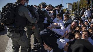 Israeli police officers clash with ultra-Orthodox Jews in Ashdod, Israel.