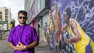 Street artist honors Kobe Bryant with murals
