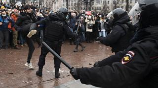 A demonstrator clashes with a police officer during a protest against the jailing of opposition leader Alexei Navalny in Moscow, Russia, Jan. 23, 2021