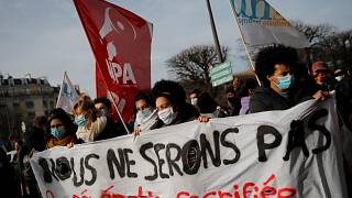 "Students demonstrate with a banner reading ""We will not be the the sacrificed generation"", Jan. 20, 2021 in Paris."