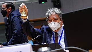 Portuguese Minister of Sea Ricardo Serrao Santos rings a bell during a EU Agriculture and Fisheries Ministers video conference meeting in Brussels, Monday, Jan. 25, 2021.