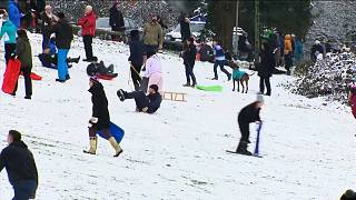 Britons enjoy snow with social distancing in mind
