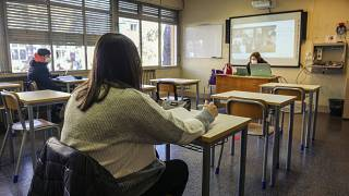 Students attend class at a high school in Rome, Monday, Jan. 18, 2021.