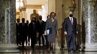 Clerk of the House Cheryl Johnson walk through Statuary Hall in the Capitol, to deliver to the Senate the article of impeachment against Donald Trump,