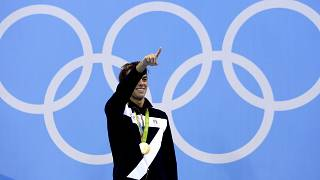 Italy's Gregorio Paltrinieri celebrates his gold during the medal ceremony for the men's 1500-meter freestyle final during the swimming competitions at the 2016 Rio Olympic.