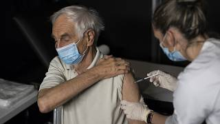 A nurse administers a dose of the Moderna COVID-19 vaccine at a vaccination center in Le Cannet, southern France, Jan. 21, 2021.