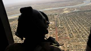 A French soldier stands inside a military helicopter on operation in Mali.