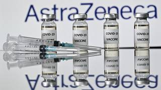 An illustration picture shows vials with Covid-19 Vaccine stickers attached and syringes with the logo of British pharmaceutical company AstraZeneca on November 17, 2020.