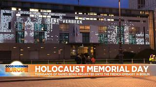 Names of the dead projected onto French Embassy in Berlin