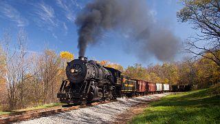 Steam Train Powers along Railway
