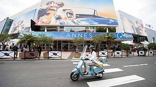A scooter drives by the Palais des Festivals at the 71st international film festival, Cannes, southern France, on May 7, 2018.