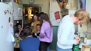 Dutch students chat in the kitchen of their shared house in Netherlands