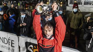 France's Yannick Bestaven lifts the trophy after winning the Vendee Globe solo around-the-world sailing race, in Les Sables-d'Olonne, France, early Thursday, Jan.28, 2021.
