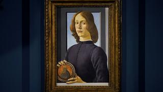 """Sandro Botticelli's """"Young Man Holding a Roundel"""" is displayed at Sotheby's in New York, Friday, Jan. 22, 2021."""