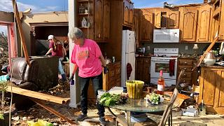 Patti Herring sobs as she sorts through the remains of her home after it was destroyed by a tornado. Fultondale, Alabama, USA. January 26, 2021