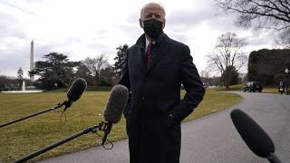 President Joe Biden speaks with reporters before boarding Marine One, Friday, Jan. 29, 2021.