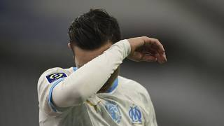 Marseille's Florian Thauvin reacts during the French League One soccer match between Marseille and Lens at the Veledrome stadium in Marseille, France, Wednesday, Jan. 20, 2021