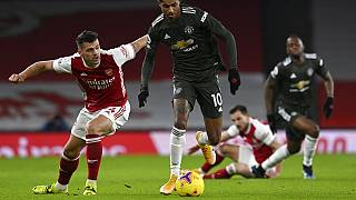 Manchester United's Marcus Rashford, right, duels for the ball with Arsenal's Granit Xhaka during the English Premier League match between Arsenal and Manchester United