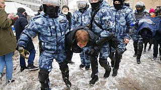 Police officers detain a man during a protest against the jailing of opposition leader Alexei Navalny in Moscow, Russia, on Sunday, Jan. 31, 2021.