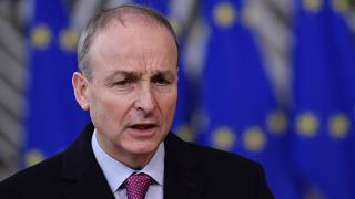 FILE - In this file photo dated Thursday, Dec. 10, 2020, Ireland's Prime Minister Micheal Martin speaks as he arrives at the European Council building in Brussels.