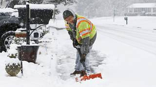Antwan Wilkerson shovels snow during a winter storm, Sunday, Jan. 31, 2021, in Mechanicsville, Va.