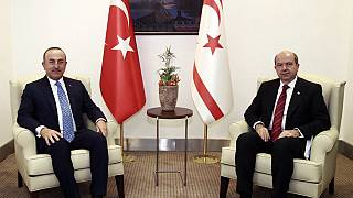 Turkey's Foreign Minister Mevlut Cavusoglu, left, and Ersin Tatar,