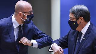 European Council President Charles Michel, left, greets Cypriot President Nicos Anastasiades