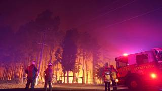 Firefighters attend a fire at Wooroloo, near Perth, Australia, Monday, Feb. 1, 2021.