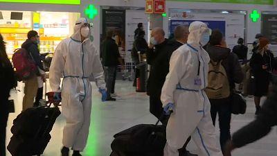 People wear Hazmat suits at airport