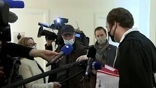 Lawyer answers journalists' questions as he arrives for a session of the council chamber in the case concerning the Paris terrorist attacks of November 2015
