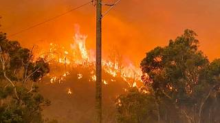 In this photo provided by Department of Fire and Emergency Services, fire burns on a hill at Wooroloo, near Perth, Australia