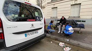 SAMU Social nurse helping homeless man on streets of Paris