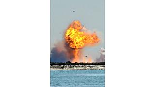 SpaceX's bullet-shaped Starship prototype explodes after crashing while attempting to land following a successful test launch, Tuesday, Feb. 2, 2021, in Boca Chica, Texas.