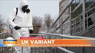 Man in hazmat suit cleans handrail in UK