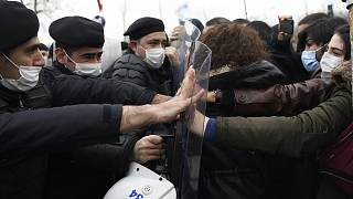 Turkish police officers clash with students of the Bogazici University protesting the appointment of a government loyalist to head their university, in Istanbul.