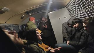 This photo released by Philipp Kyznetsov shows a group of detained people inside the police bus in Moscow, Russia