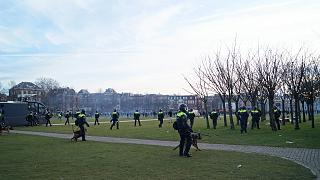 Police in action against protesters on Museumplein in Amsterdam.