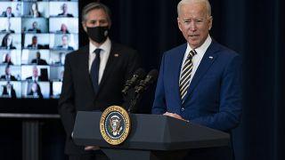 Secretary of State Antony Blinken listens as President Joe Biden delivers remarks to State Department staff, Thursday, Feb. 4, 2021, in Washington.