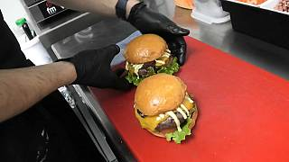 Juan Diego Gaitán prepares burgers in his 'dark kitchen' in Madrid