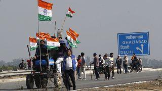 Indian farmers block an expressway at Kundli in Haryana, India, Saturday, Feb. 6, 2021.