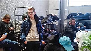 Detained people inside the deportation centre Sakharovo, in Moscow, Russia, Thursday, Feb. 4, 2021.