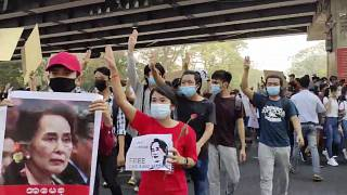 In this image provided by the Democratic Voice of Burma (DVB), protesters in Yangon hold images of deposed Myanmar leader Aung San Suu Kyi, Sunday, February 7, 2021.