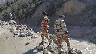 This photograph provided by Indo Tibetan Border Police (ITBP) shows ITBP personnel after a portion of Nanda Devi glacier broke off, Uttarakhand, India, February 7, 2021.